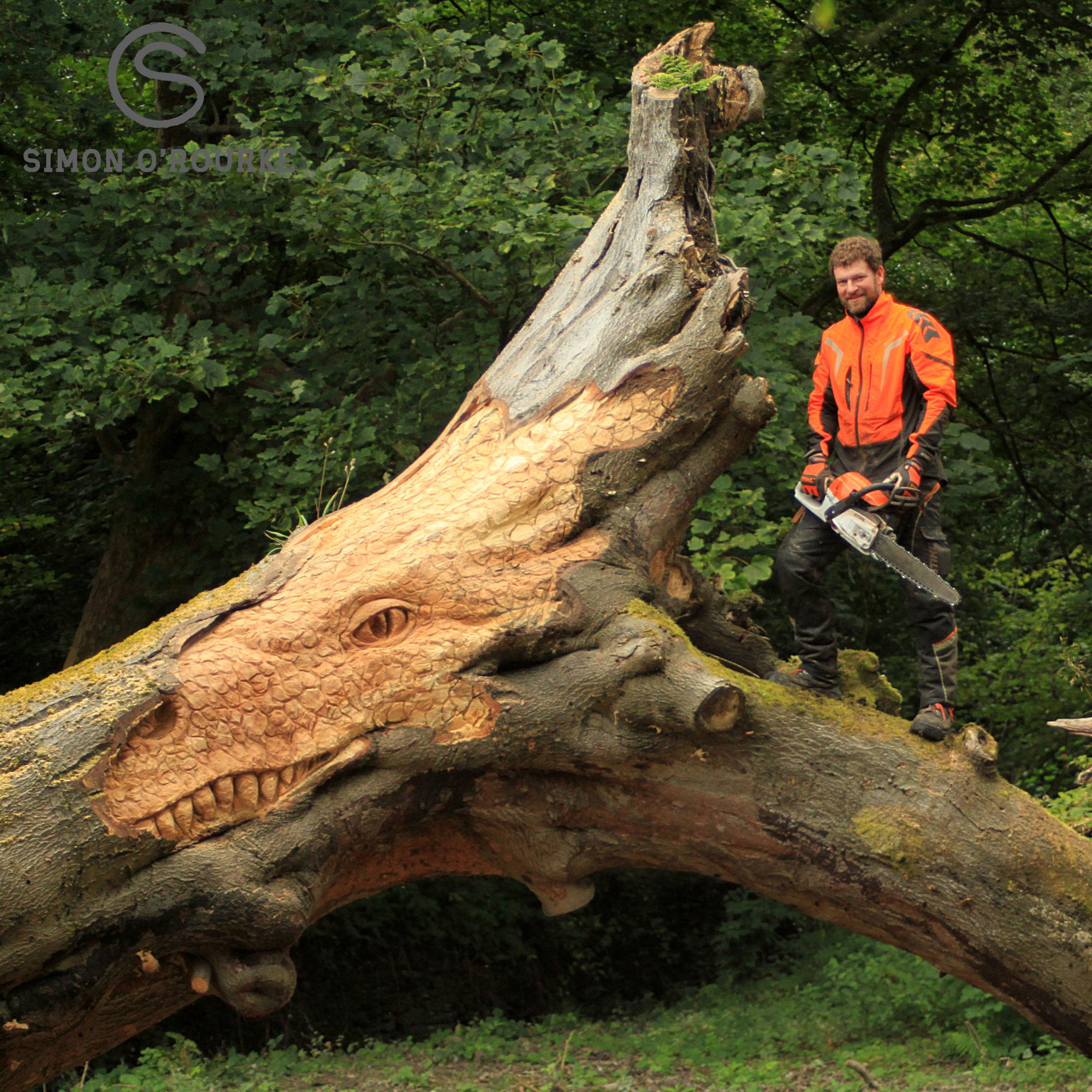 Carving a dragon into a fallen tree