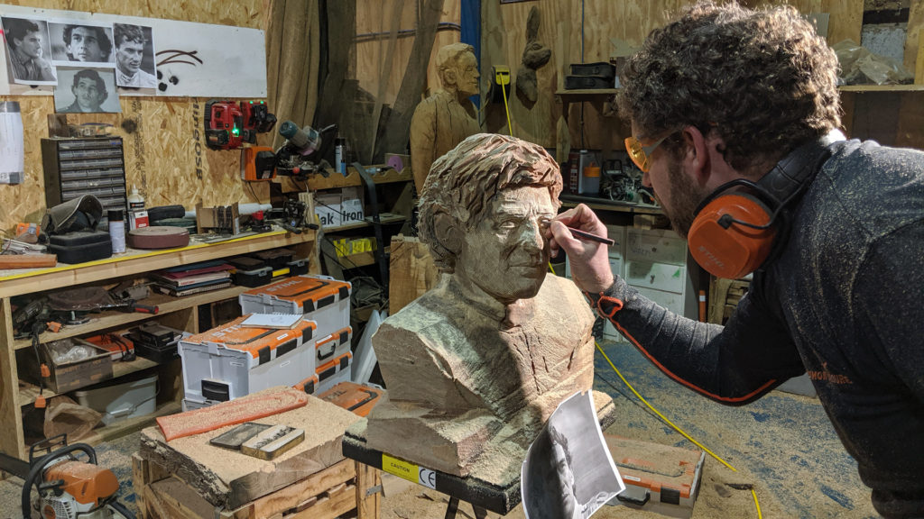 Simon o'Rourke working on the eyes of his Ayrton Senna tribute sculpture