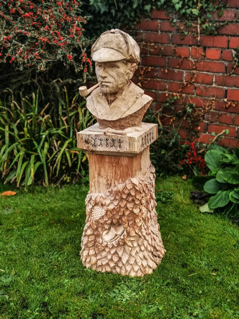Sherlock Holmes tree carving statue by Simon O'Rourke