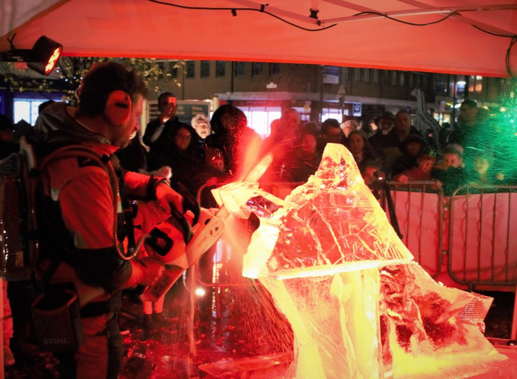 Crowds watching Simon O'Rourke Ice Carving for Wrexham Museum