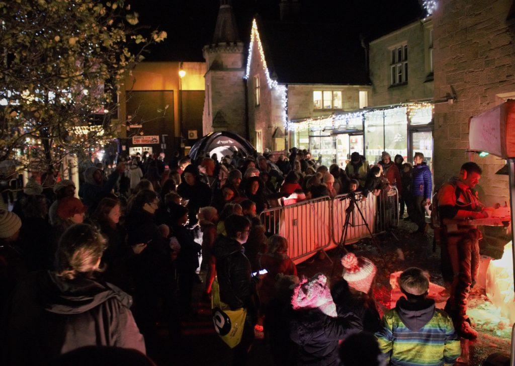 Crowds watching ice carving for Wrexham Museum