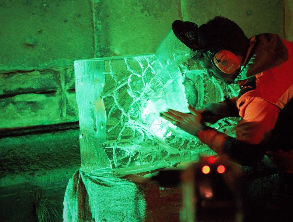 Simon O'Rourke working on an ice carving of a dragon's eye, Wrexham 2019