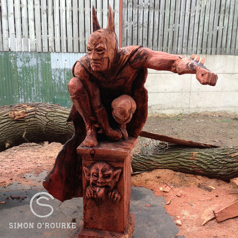 Wooden Batman carving by Simon O'Rourke