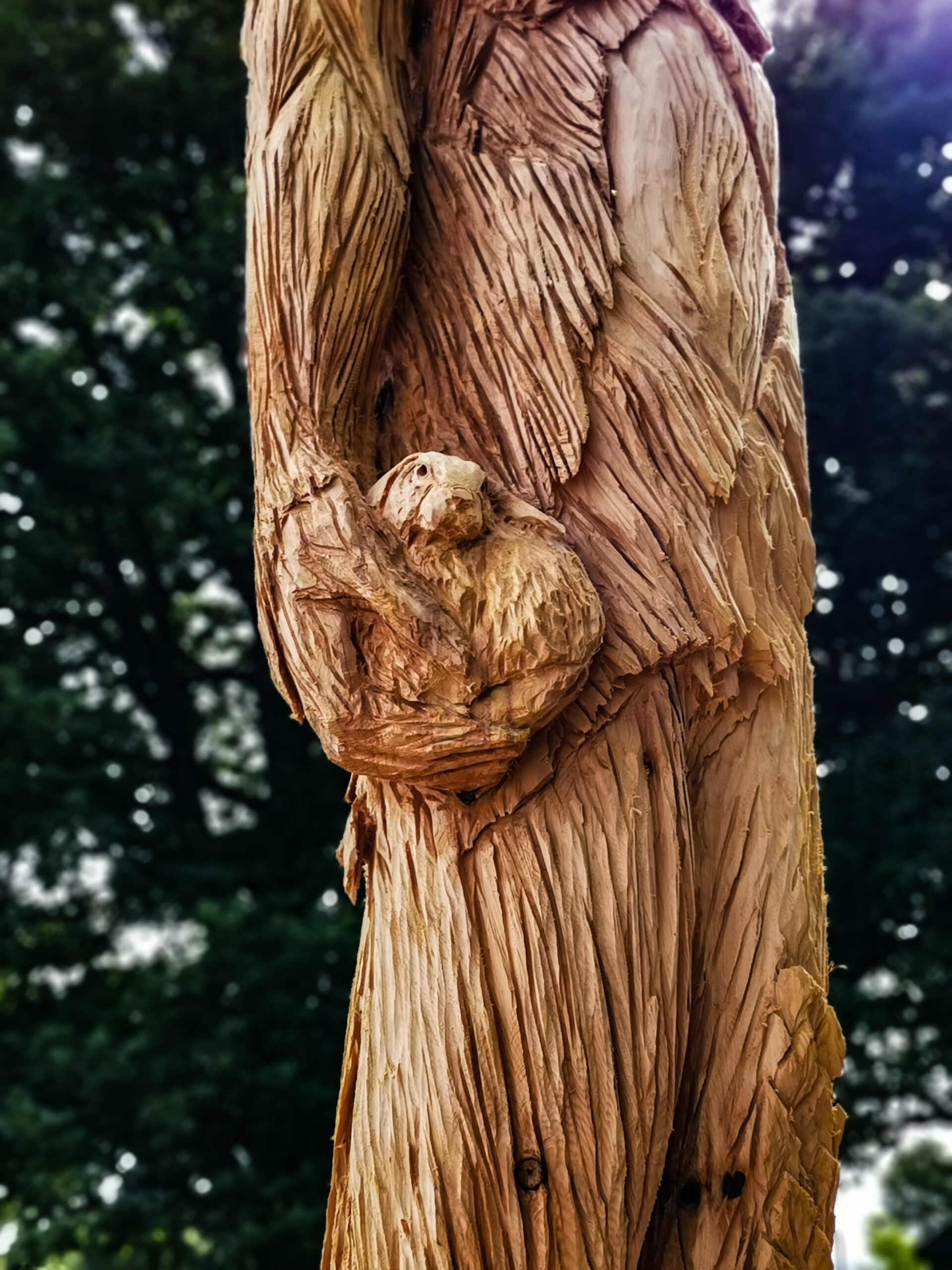 close up of the ent tree sculpture by simon o'rourke, focusing on the rabbit in its left hand