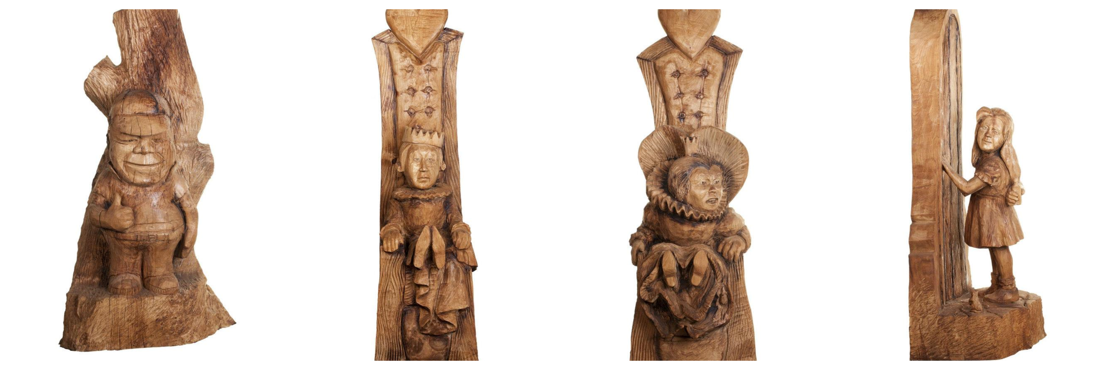 Alice in Wonderland sculpture by chainsaw artist simon o'rourke. Figures carved in wood of around 6' show the quuen of hearts, king of hearts, alice and tweedle dum