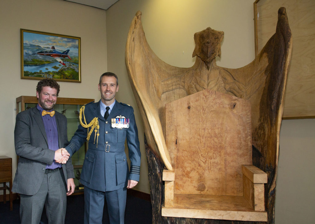 Simon O'Rourke with RAF Valley Station Commander Chris Jones and the completed dragon throne