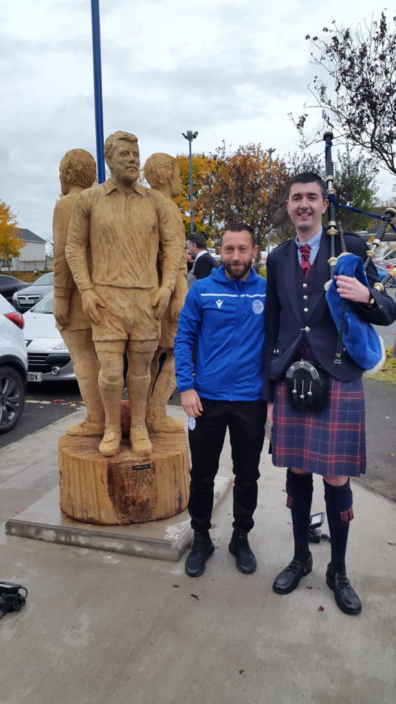Stephen Dobbie with his likeness at the unveiling of the Queen of the South Legends by Simon O'Rourke