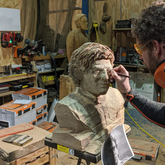 Simon o'Rourke working on the eyes of his Ayrton Senna tribute sculpture