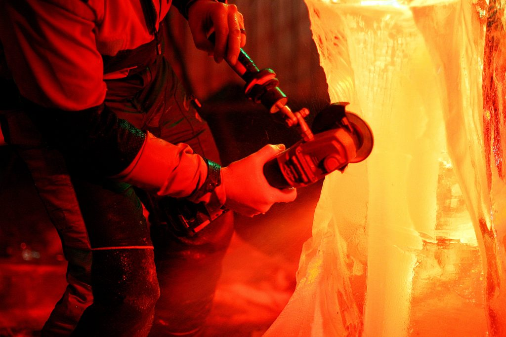 Simon O'Rourke adding detail to an ice carving dragon, Wrexham 2019