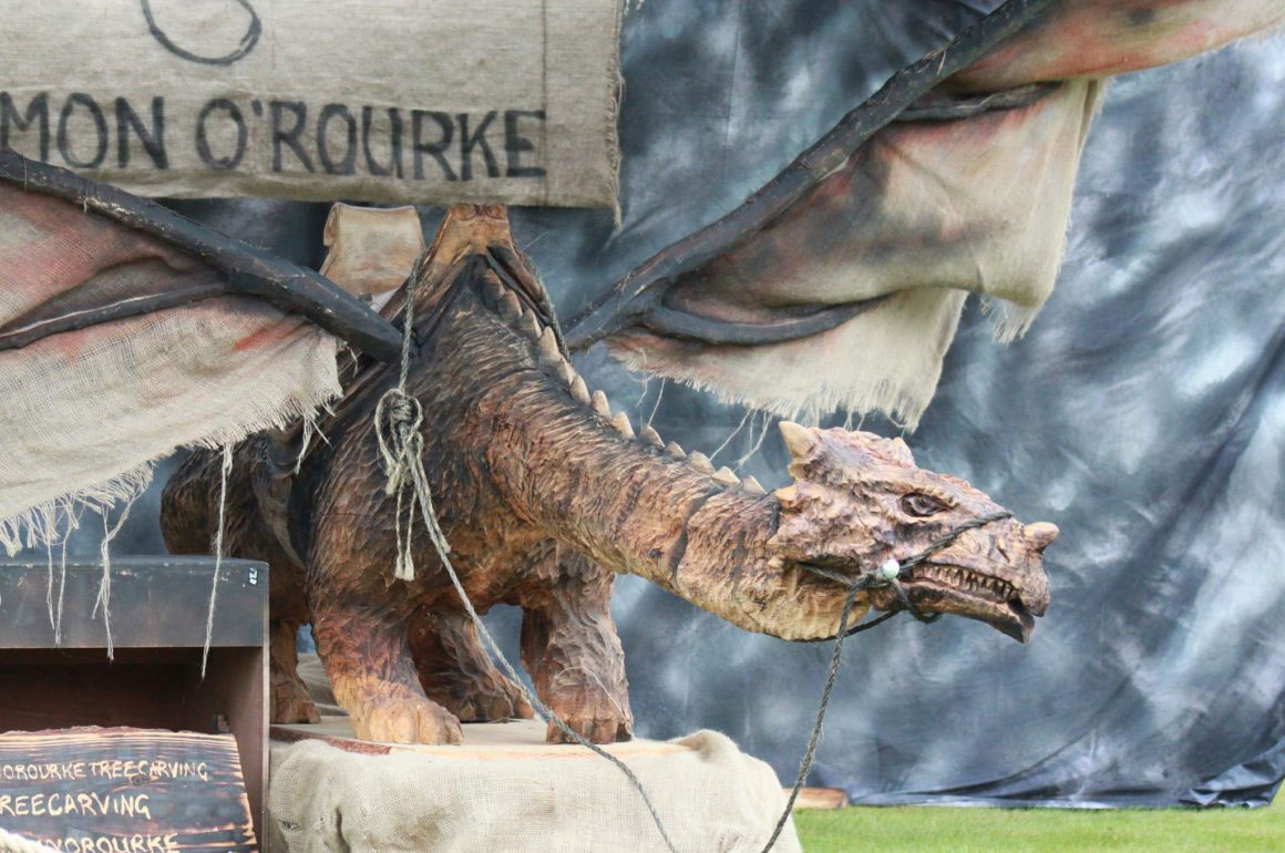 moving wood sculpture of a dragon by simon o'rourke