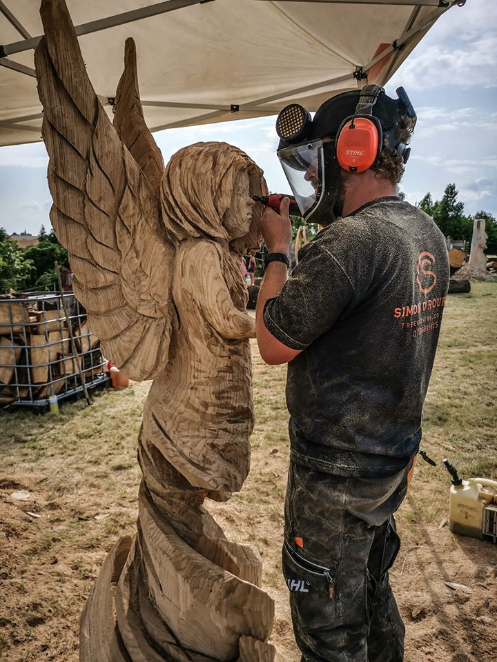 Simon O'Rourke carving a fairy