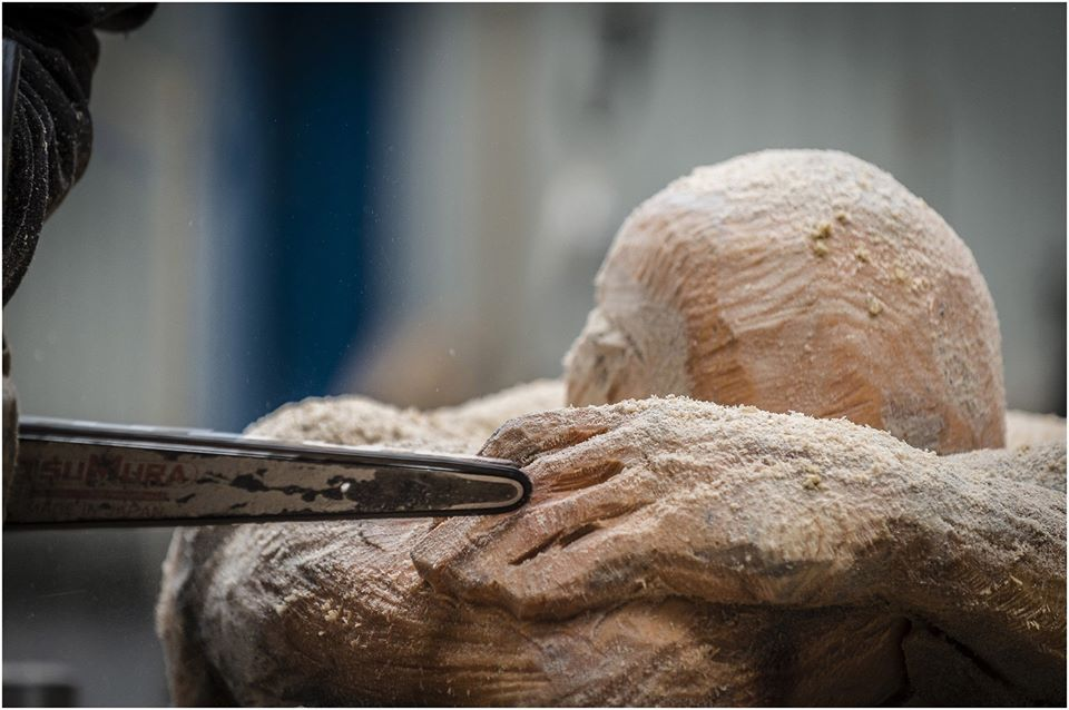 close up of a chainsaw bar from a carving in process by Simon O'Rourke