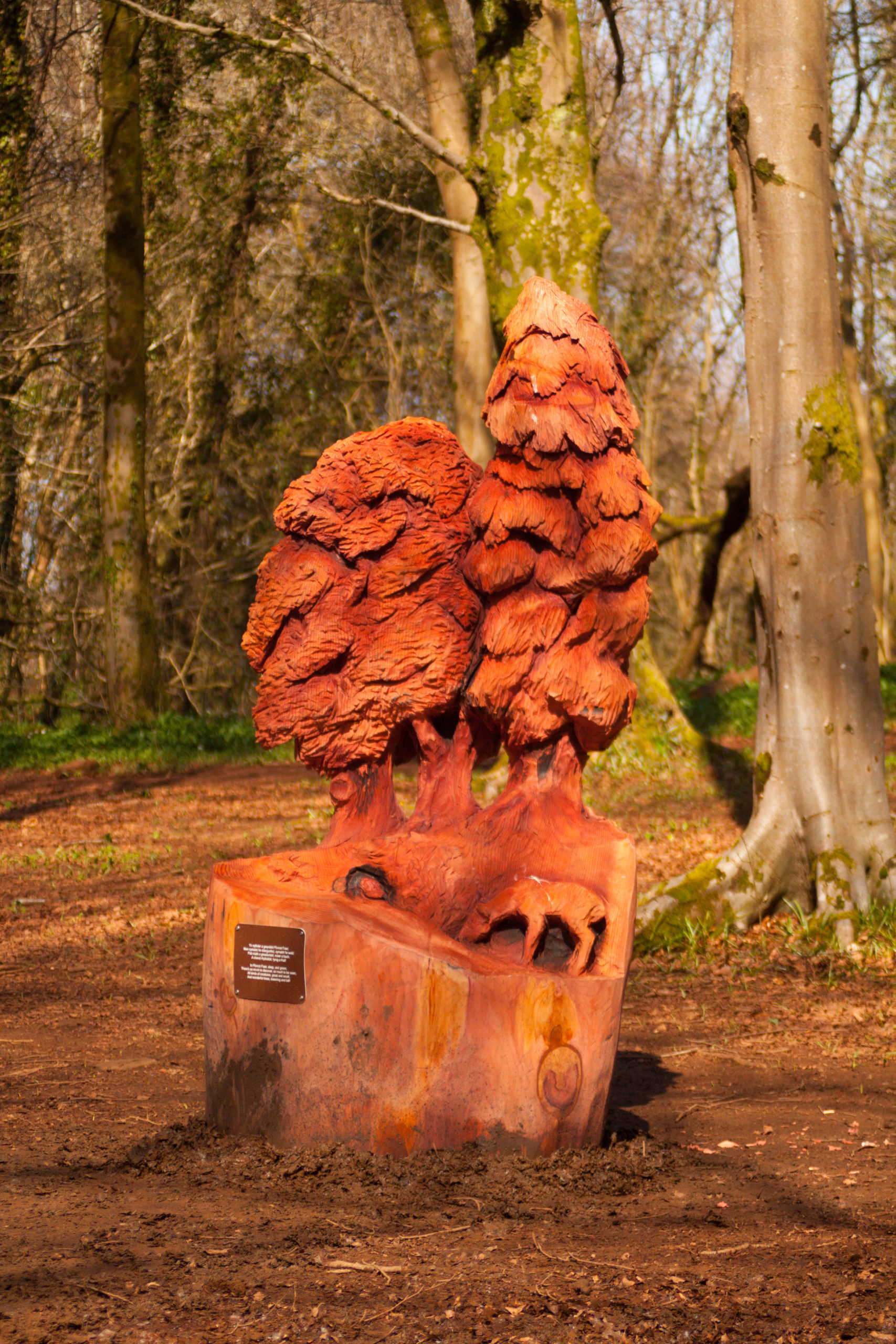 Simple redwood sculpture of trees as part of simon o'rourke's tree carving chainsaw art woodland sculpture trail in fforest fawr