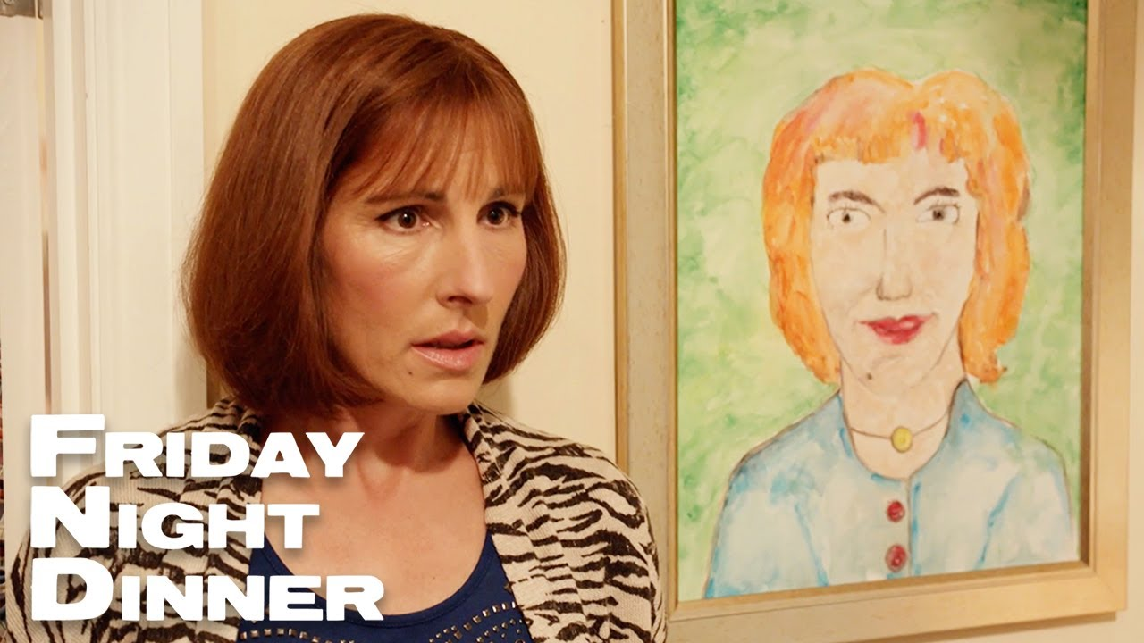 Actress Tamsin Greig in character as Jackie from Friday Night Dinner, standing next to the comedic portrait her onscreen husband painted.