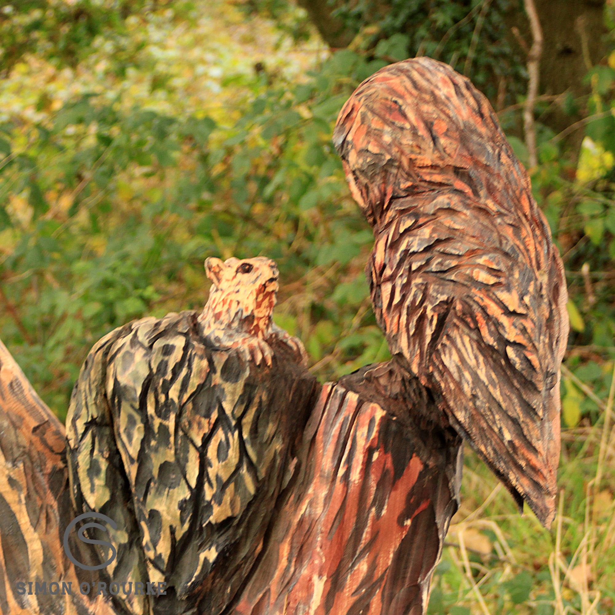 Tree carving sculpture of ruby the owl and a squirrel