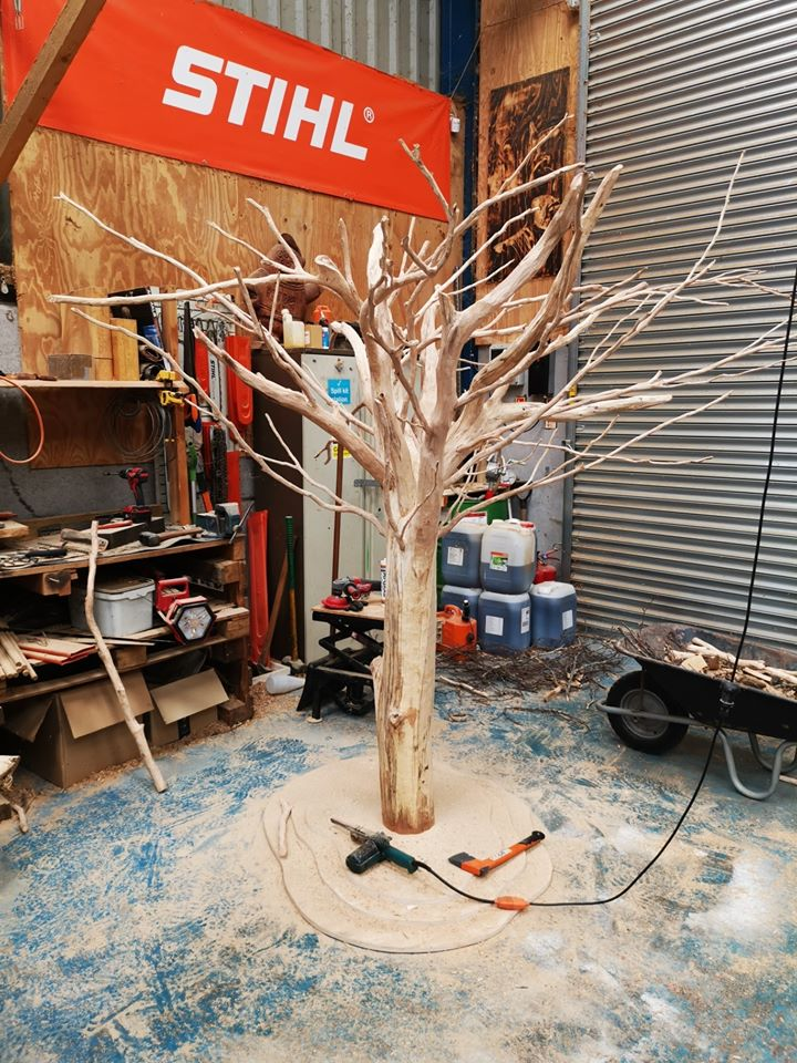 the 'giving tree sculpture' by Simon o'rourke. the photo shows the tree in simon's workshop while it is in progress