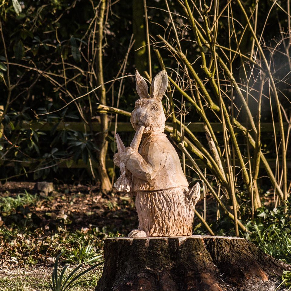 sculptures based on literature by chainsaw artist simon o'rourke: Peter Rabbit eating carrots