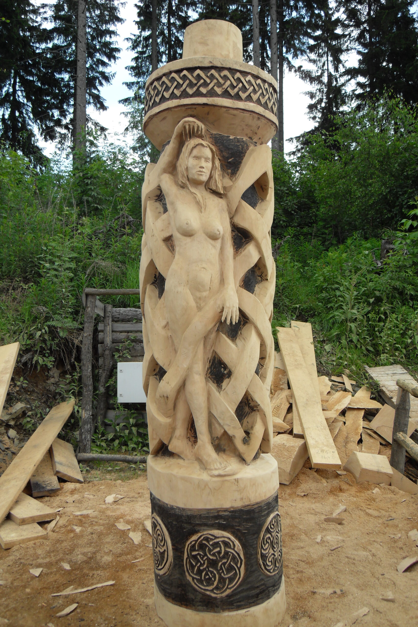celtic knot column featuring nude woman by simon o'rourke
