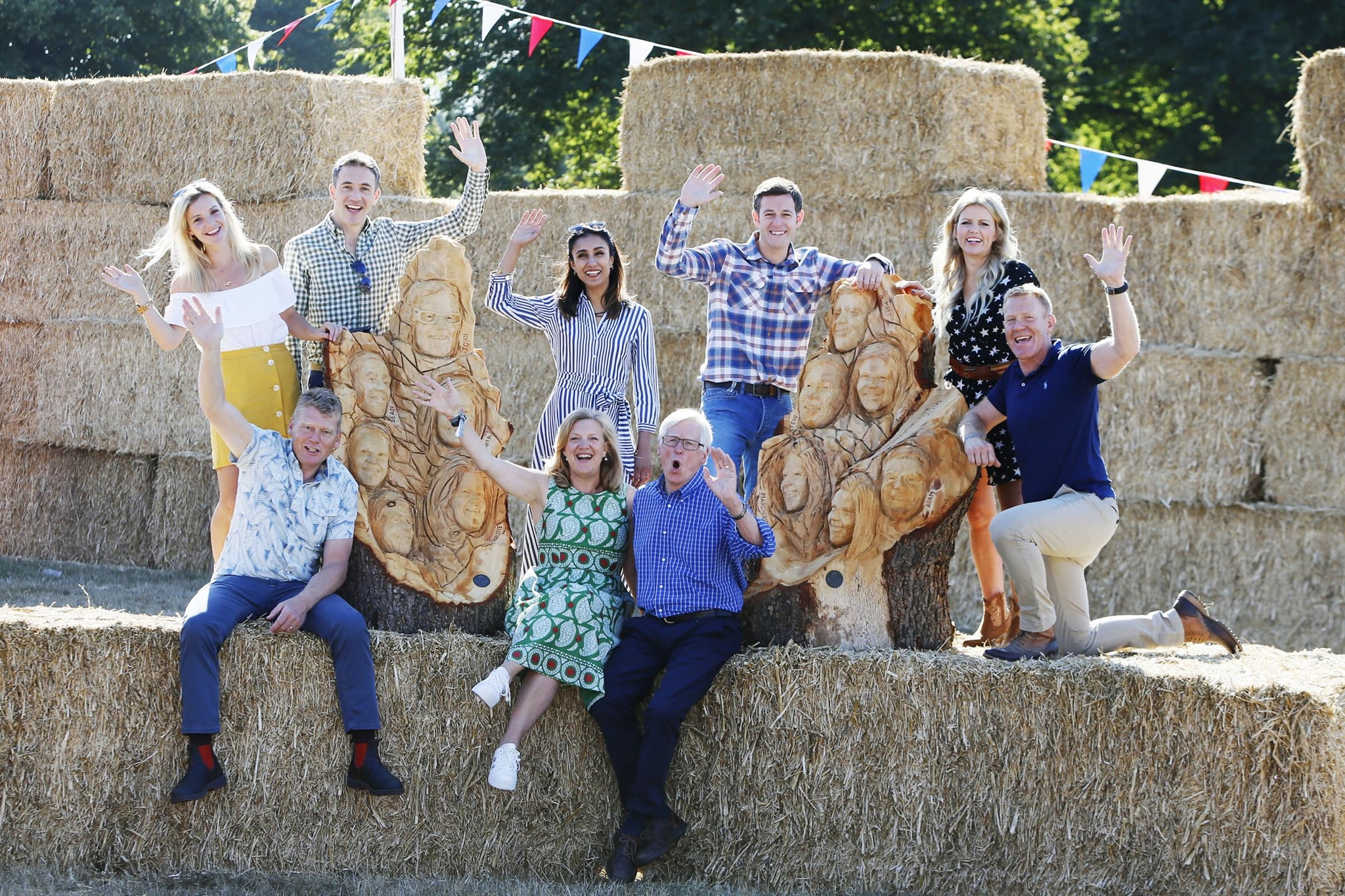 TV themed sculptures by simon o'rourke. Countryfile presenters sitting with their likelnesses carved into two pieces of wood by simon o'rourke