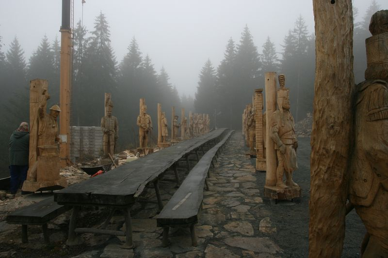 life size miners created by various chainsaw artists act as pillars for a canopy over a 40m table