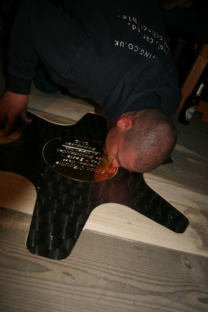 Chainsaw artist SImon o'Rourke kisses his star in the blockhausen walk of fame