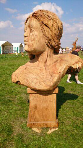 giant wood bust of a female. one of simon o'rourke's english open chainsaw competition entries