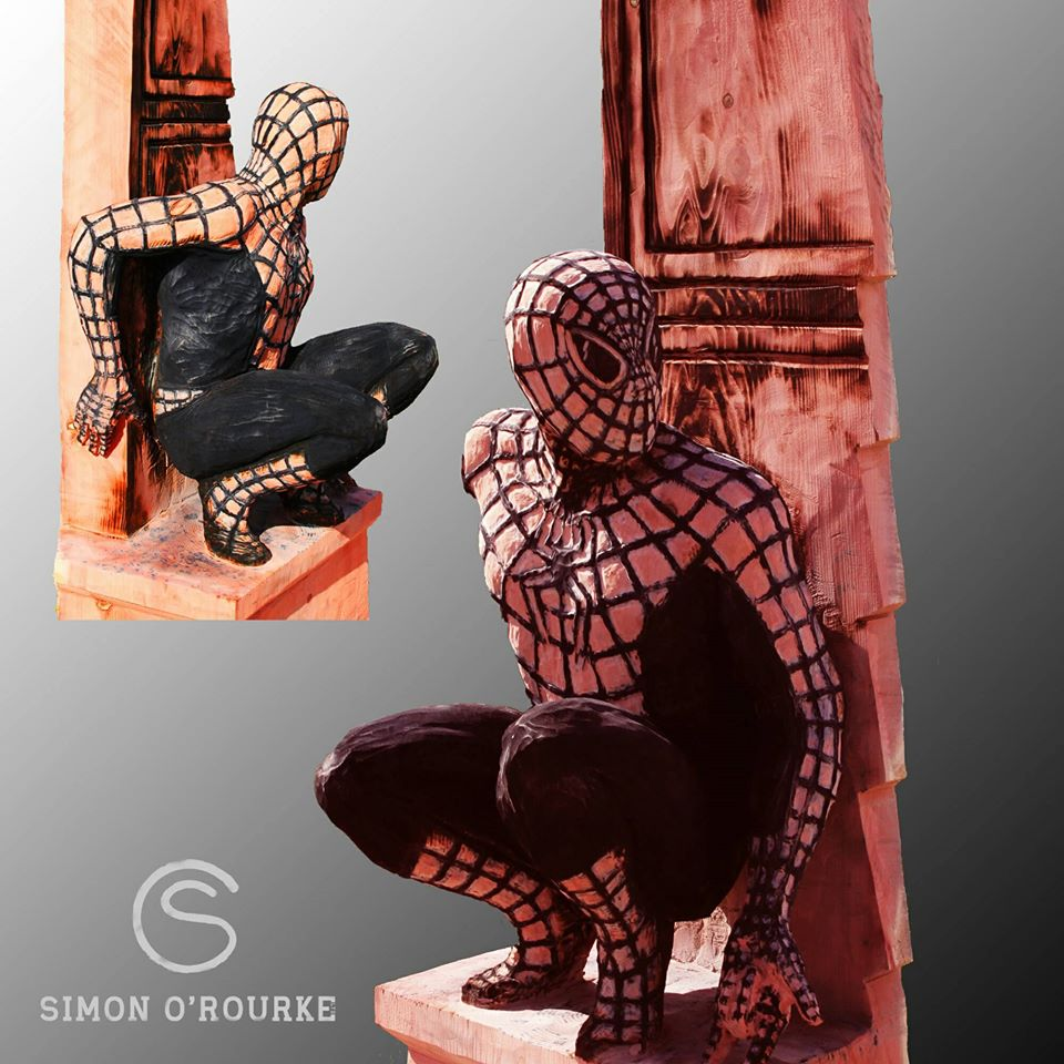 movie based sculptures: life sized spiderman wood sculpture created by simon o'rourke