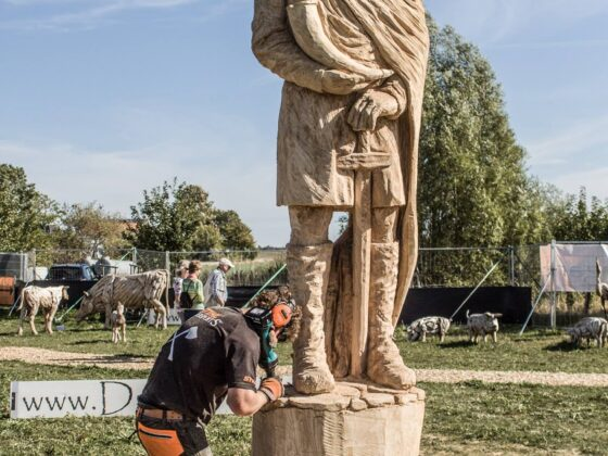 Chainsaw artist Simon O'Rourke putting finishing touches on a 3m sculpture of svantevit, the slavic god of war. Svantevit is one of his many sculptures of myths and legends.