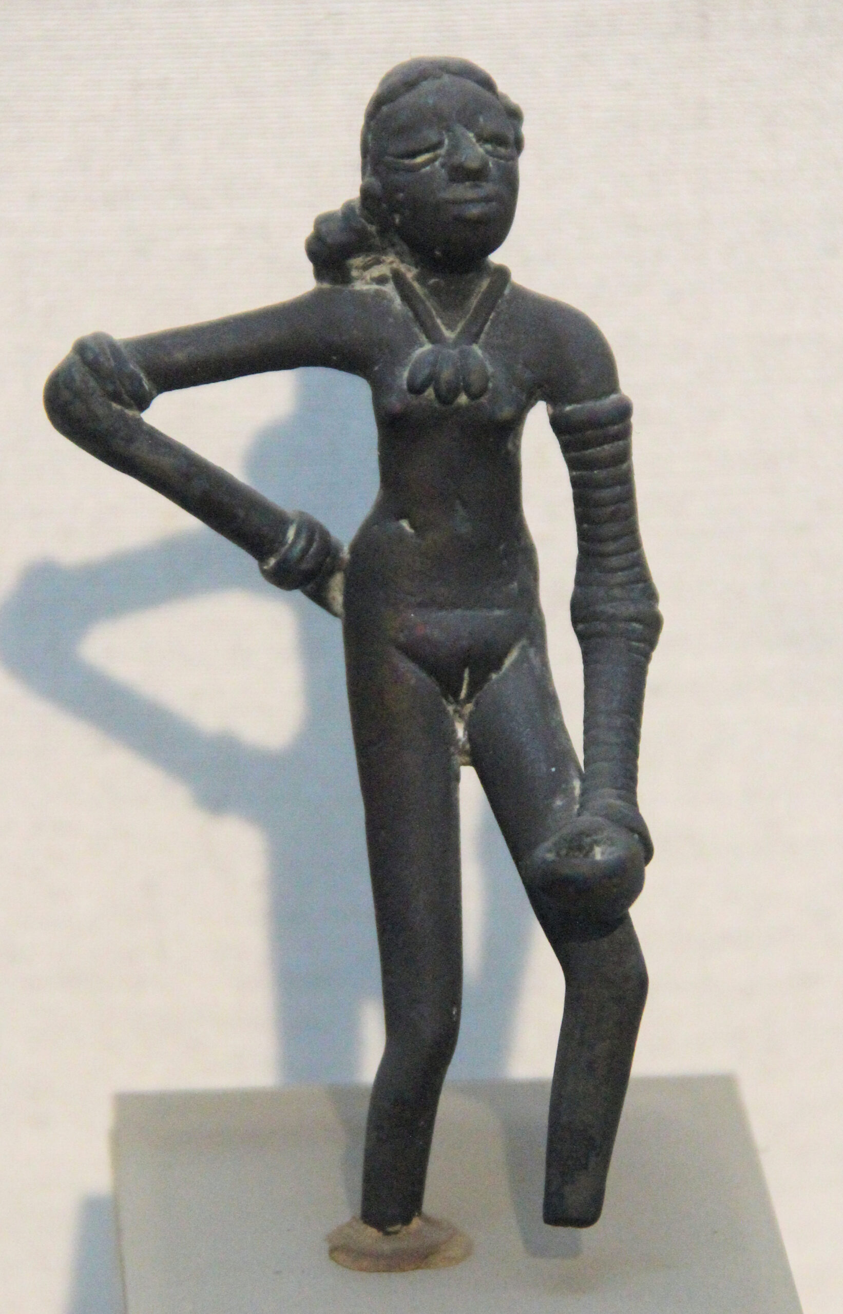 Wood or Broze sculpture? Photo shows the bronze sculpture of dancing girl of mohenjo-daro