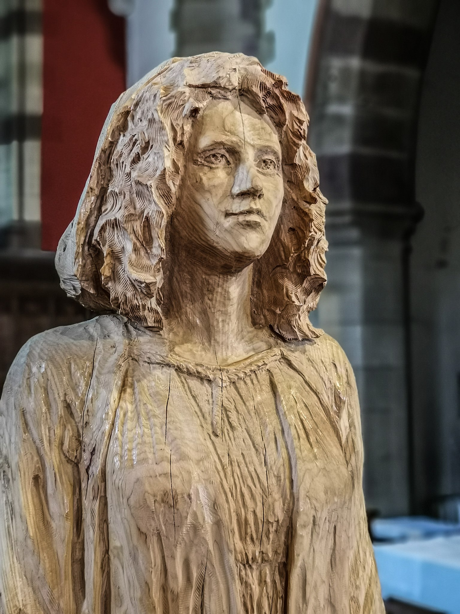 life size sculpture of a young female carved from oak by Simon O'Rourke