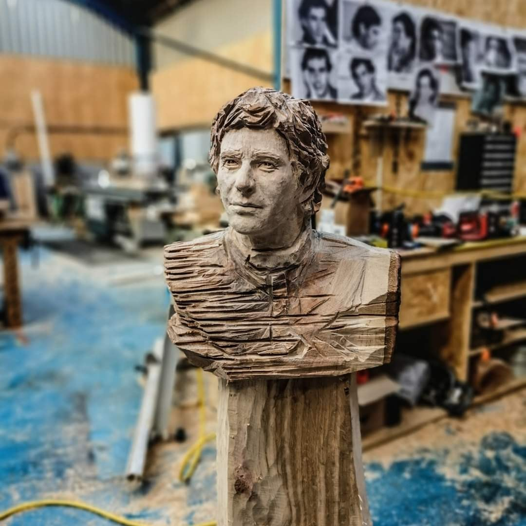 a wood carved bust of F1 driver Ayrton senna in the workshop of creator Simon O'Rourke