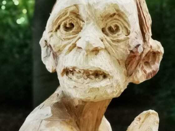 face of the gollum sculpture at poulton hall by simon o'rourke