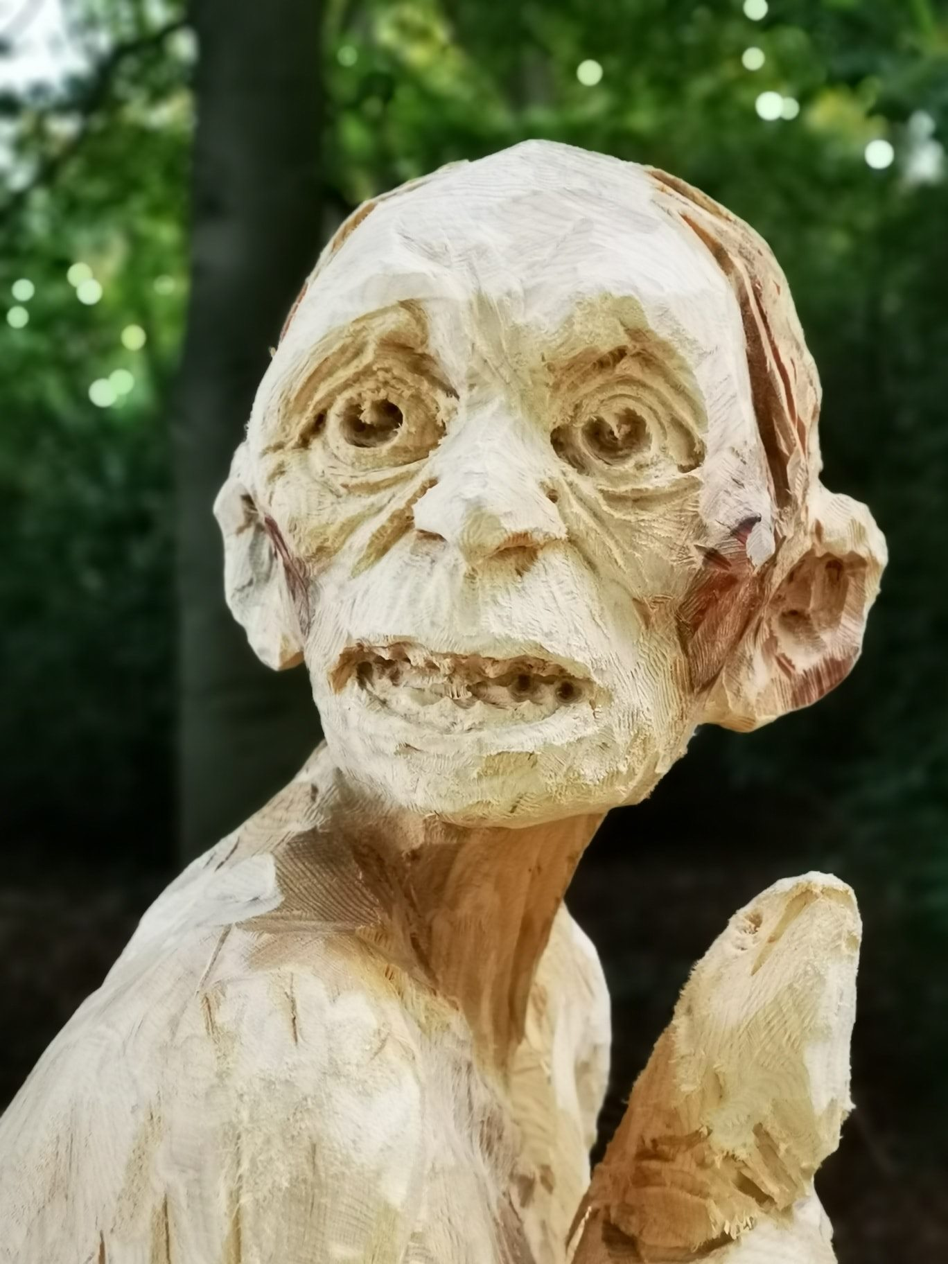 close up of the face of the gollum sculpture created by chainsaw artist simon o'rourke