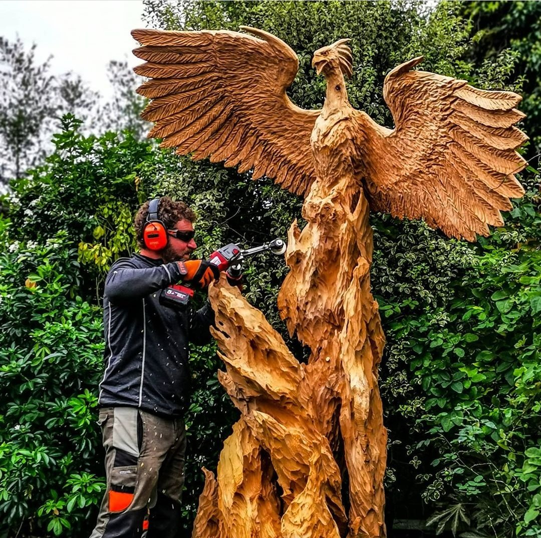Chainsaw artist simon o'rourke is using one of his favourite manpatools for creating texture on sculptures. The round cutter tool is being used to add texture to flames as a phoenix rises from them.