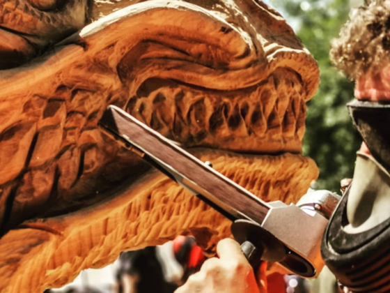 Close up of Simon O'Rourke using the manpatools belt sander to refine the mouth of a water dragon. It is one of his favourite manpatools for creating texture on sculptures.
