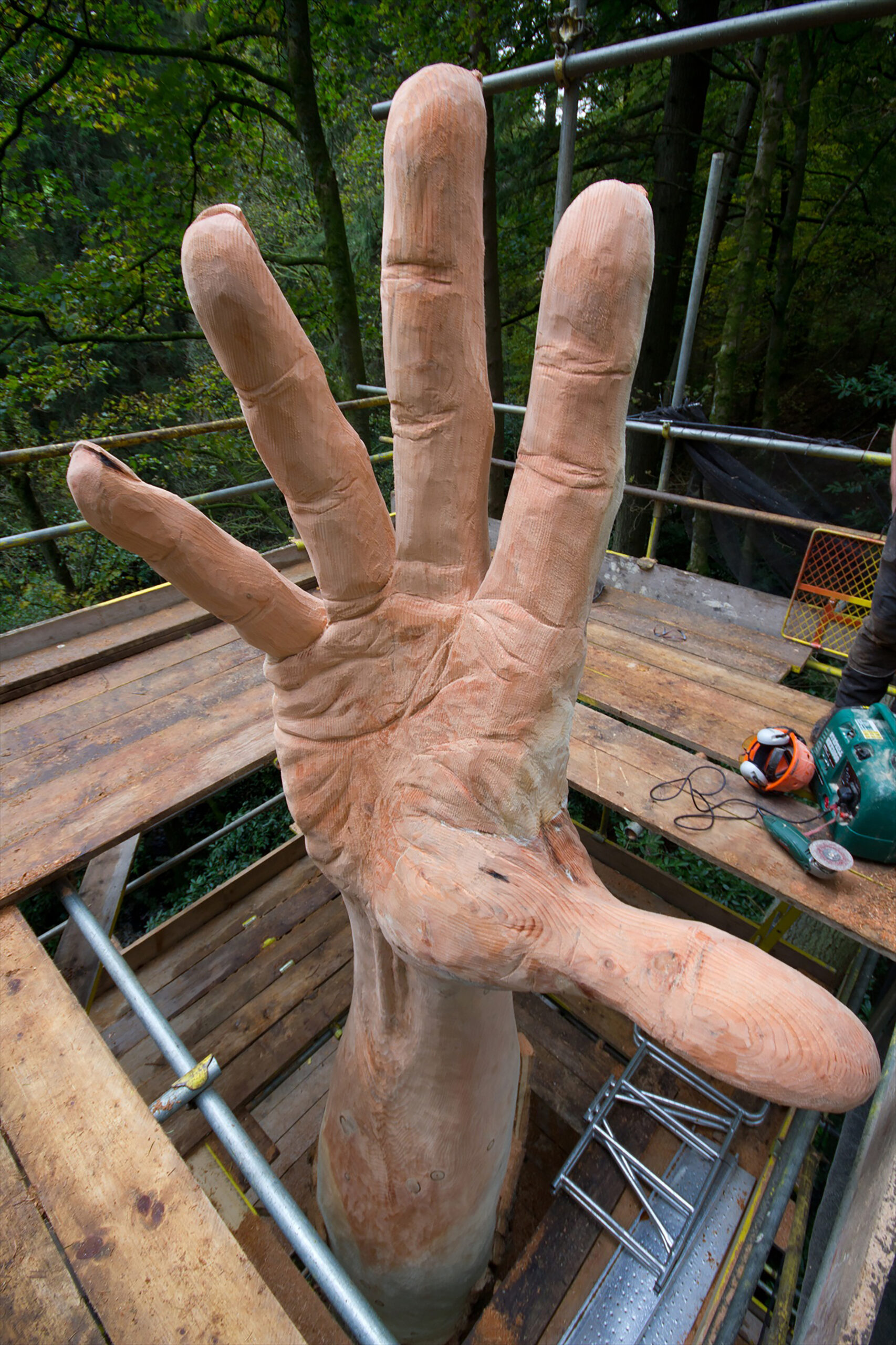 close up view of the giant hand of vyrnwy, showing creases and veins and stretch in the hand