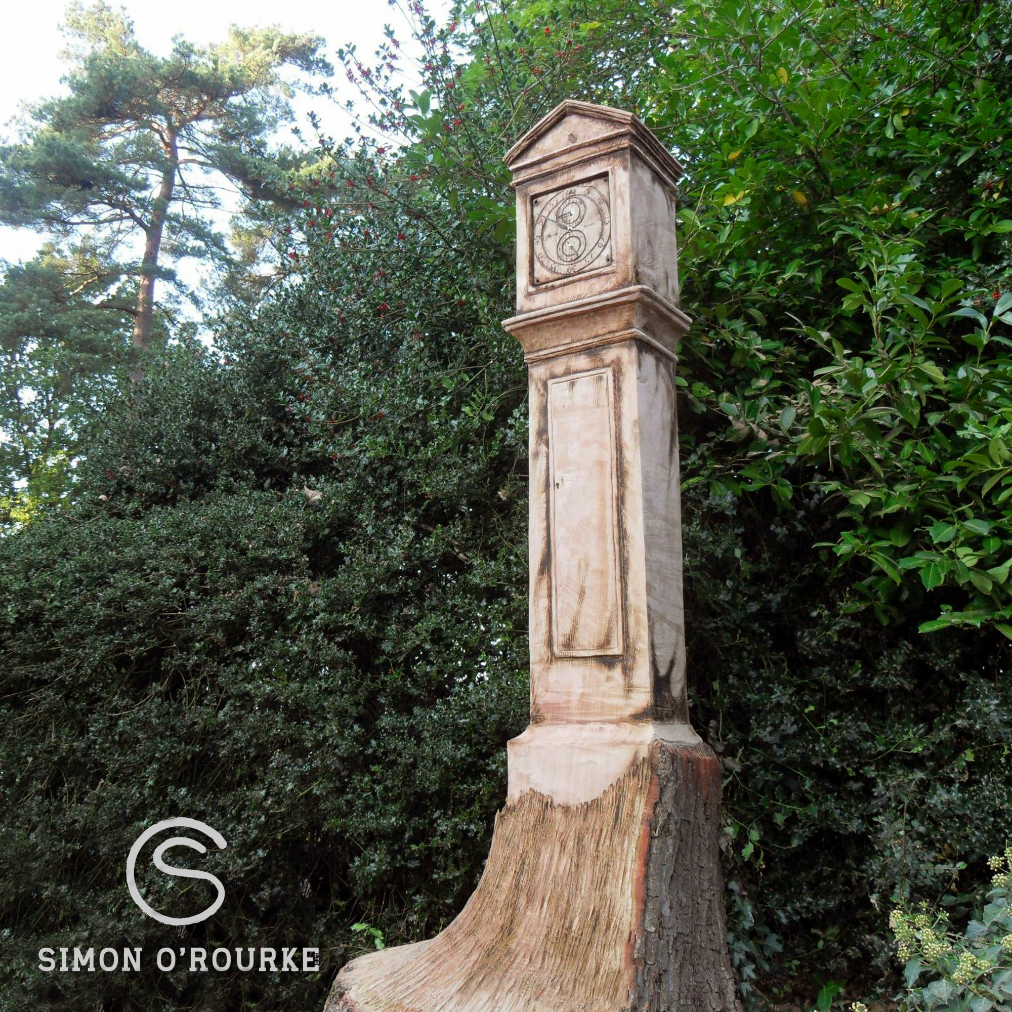 How long will my wood sculpture last? Photo shows a wooden sculpture of a grandfather clock, turning an ashy grey colour. There are no signs of splits or cracks.