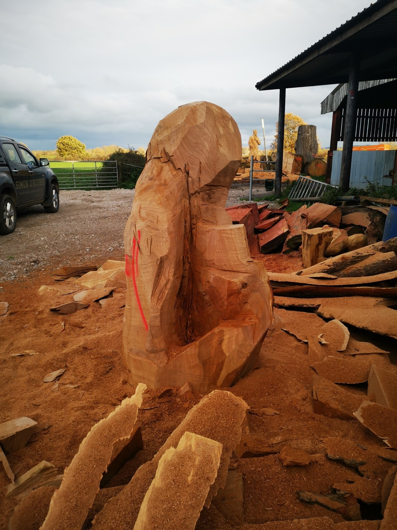 an abandoned unfinished wood sculpture of a lion