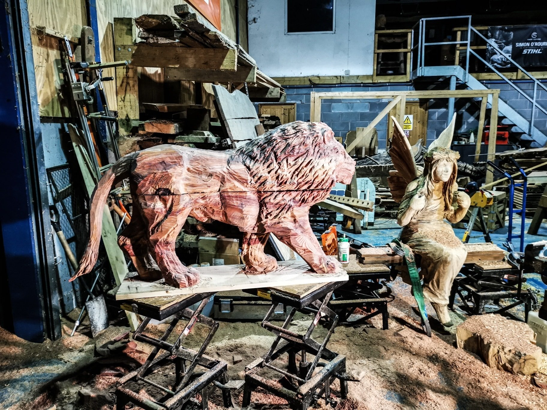 redwood lion sculpture in a workshop