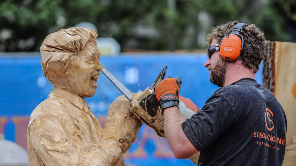 Simon O'Rourke uses a chainsaw to carve a lifesize portrait of Ken Dodd