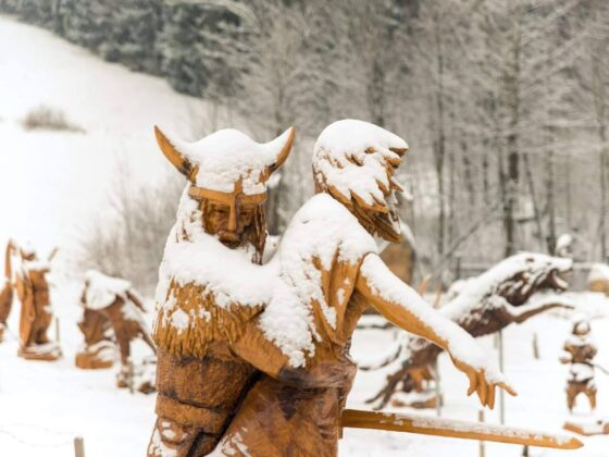 sculptures in the snow: Viking raid by Simon O'Rourke, depicting a viking kidnapping a young woman
