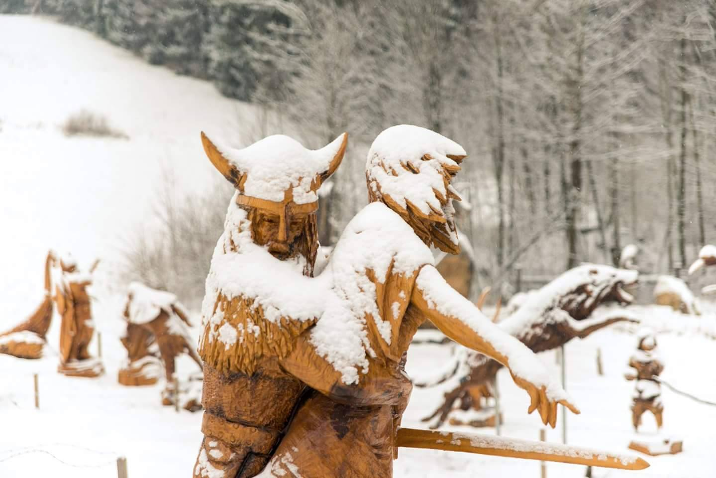 sculptures in the snow: Viking raid by Simon O'Rourke. A viking kidnaps a young woman. Her father kneels in anguish.