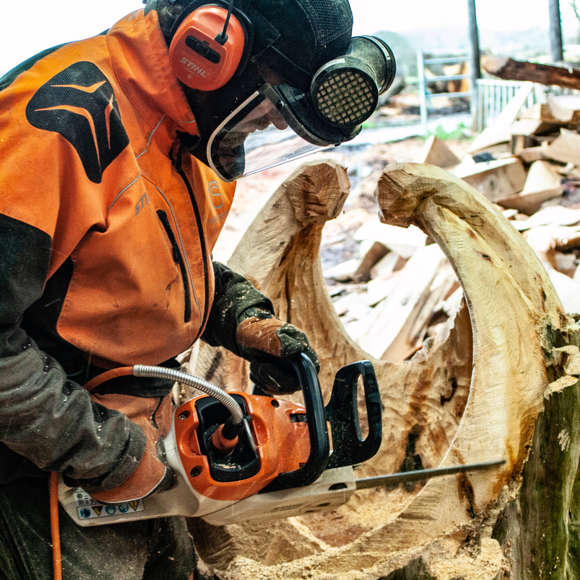 Simon O'Rourke using a chainsaw to create his game of thrones sculpture: a dragon egg casket