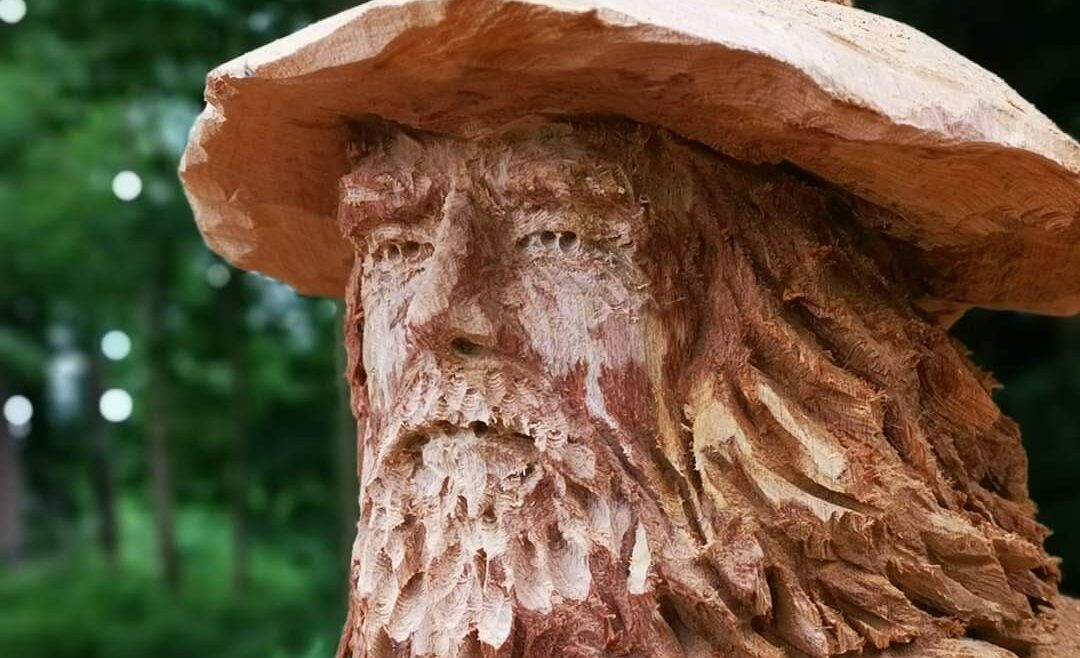 who are your influences? photo shows a close up of a wizard carved in oak by simon o'rourke. it has a rough, unrefined and highly textured finish. This is close to the work of influences on him like Rodin and Degas.