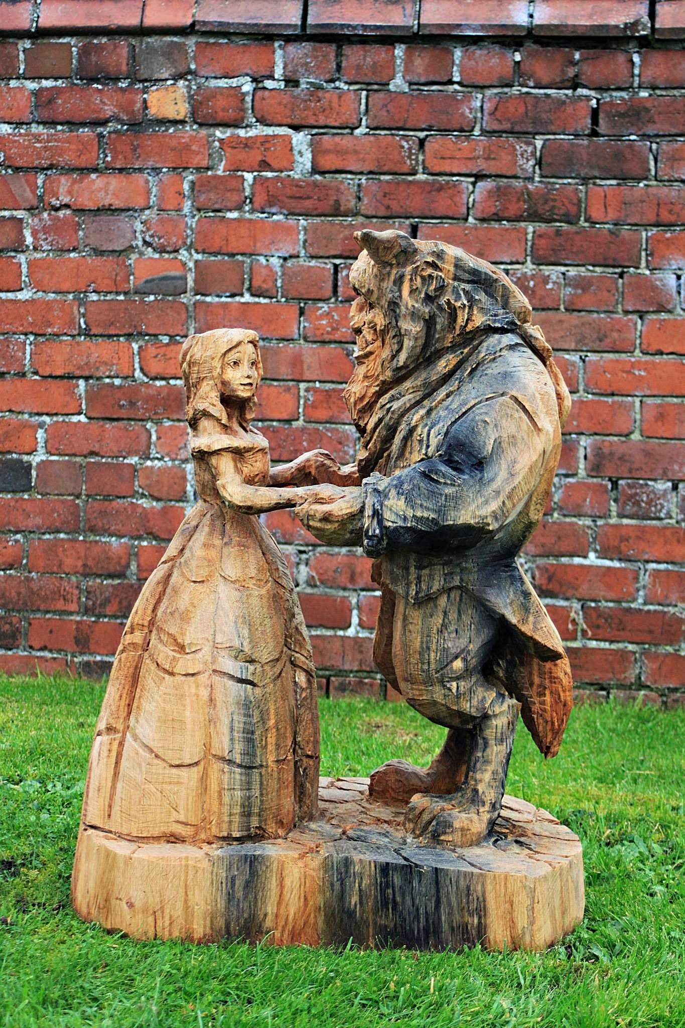 Romance-themed sculptures by Simon O'Rourke. A wooden sculpture of Beauty and the Beast dancing together.