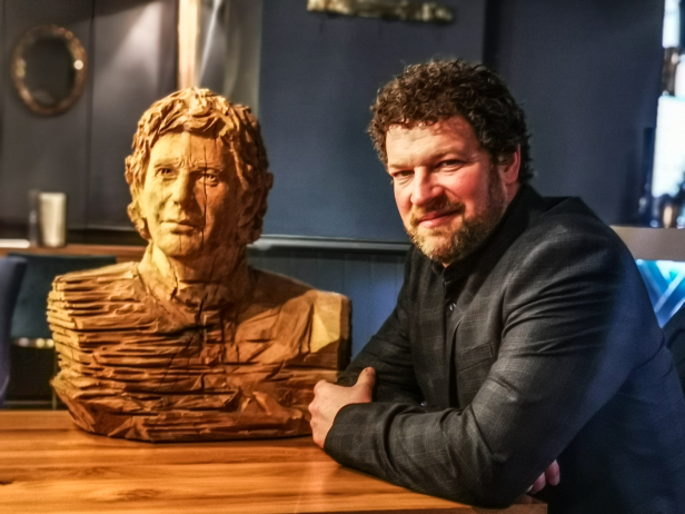 Simon O'Rourke photographed with the wooden bust he created of Ayrton Senna.