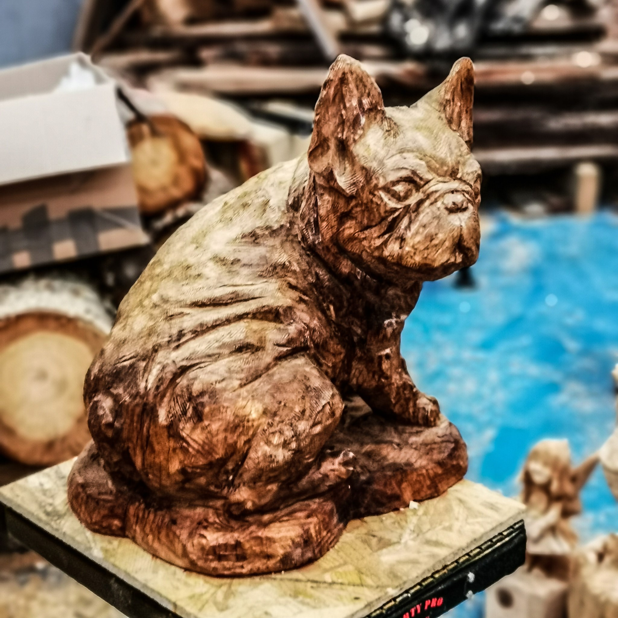 why is art expensive? photo shows a small wooden sculpture of a bulldog by simon o'rourke.