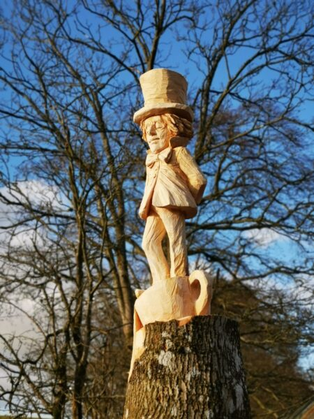 Pantpurlais mad hatter sculpture against a background of bare trees