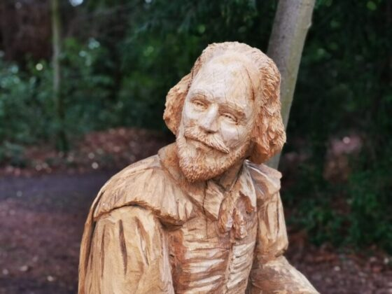 close up of the face of Simon O'Rourkes bespoke shakespeare seat at poulton hall