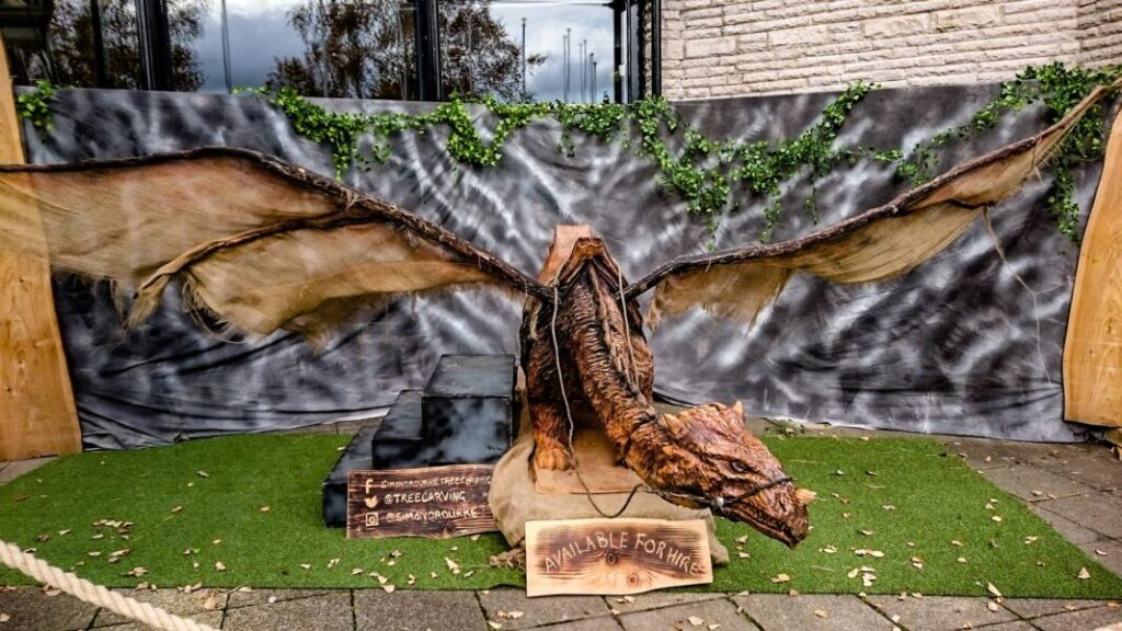 picture shows a dragon carved in oak by simon o'rourke